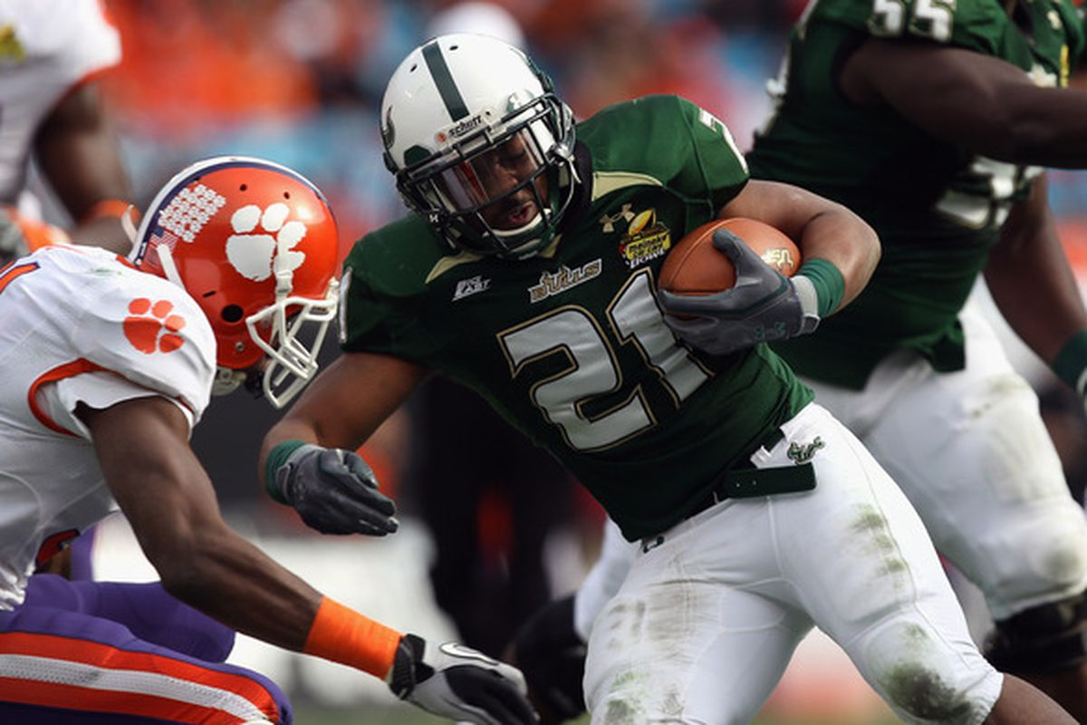 CHARLOTTE NC - DECEMBER 31:  Demetris Murray #21 of the USF Bulls runs with the ball against the Clemson Tigers during their game at Bank of America Stadium on December 31 2010 in Charlotte North Carolina.  (Photo by Streeter Lecka/Getty Images)