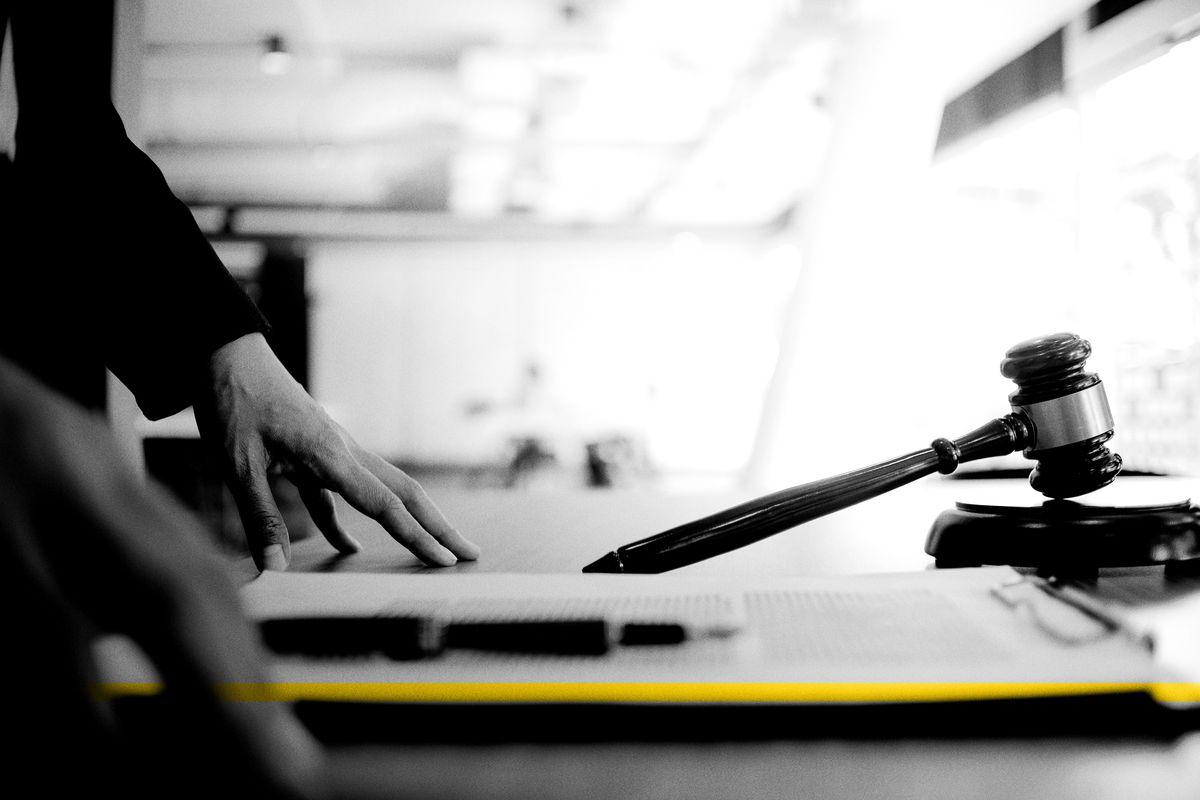 A judge's gavel sits on a judge's desk.
