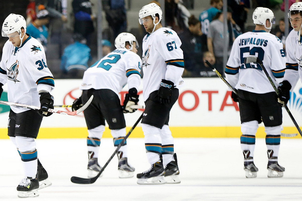 The San Jose Barracuda skate off the ice after being defeated in their inaugural game 4-2 by the Rockford IceHogs at SAP Center on Friday night. (Josie Lepe/Bay Area News Group)