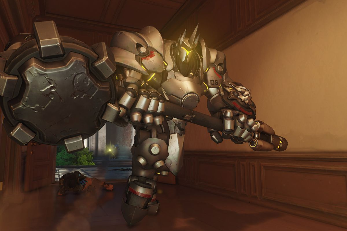 Reinhardt from Overwatch carrying his hammer