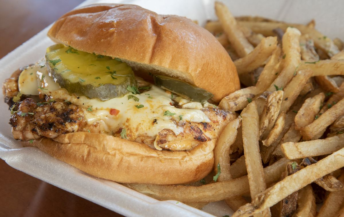 The grilled chicken sandwich is served at BaseHit BBQ & Catering.