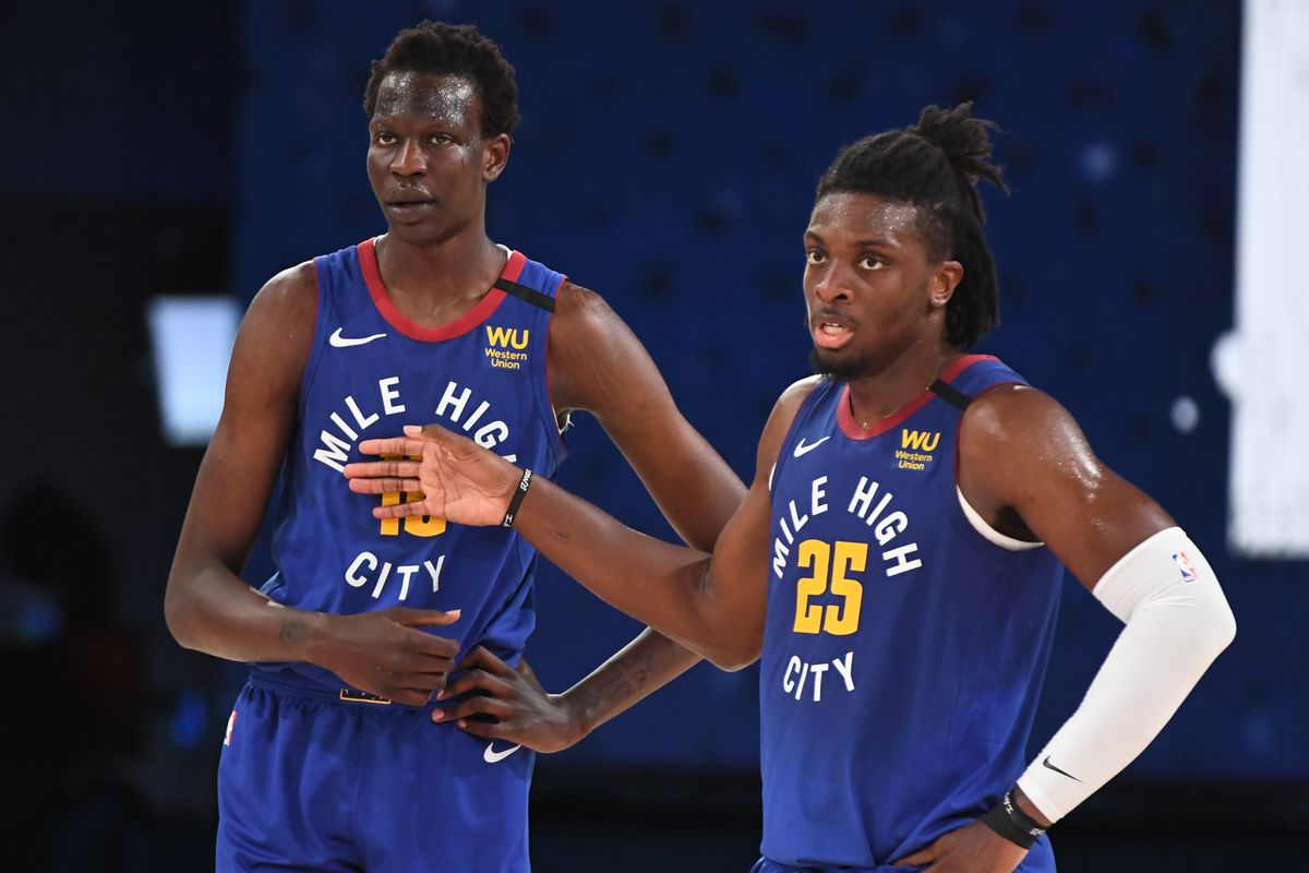 Bol Bol of the Denver Nuggets and Tyler Cook of the Denver Nuggets huddle up during a scrimmage on July 25, 2020 at The Arena at ESPN Wide World of Sports in Orlando, Florida.