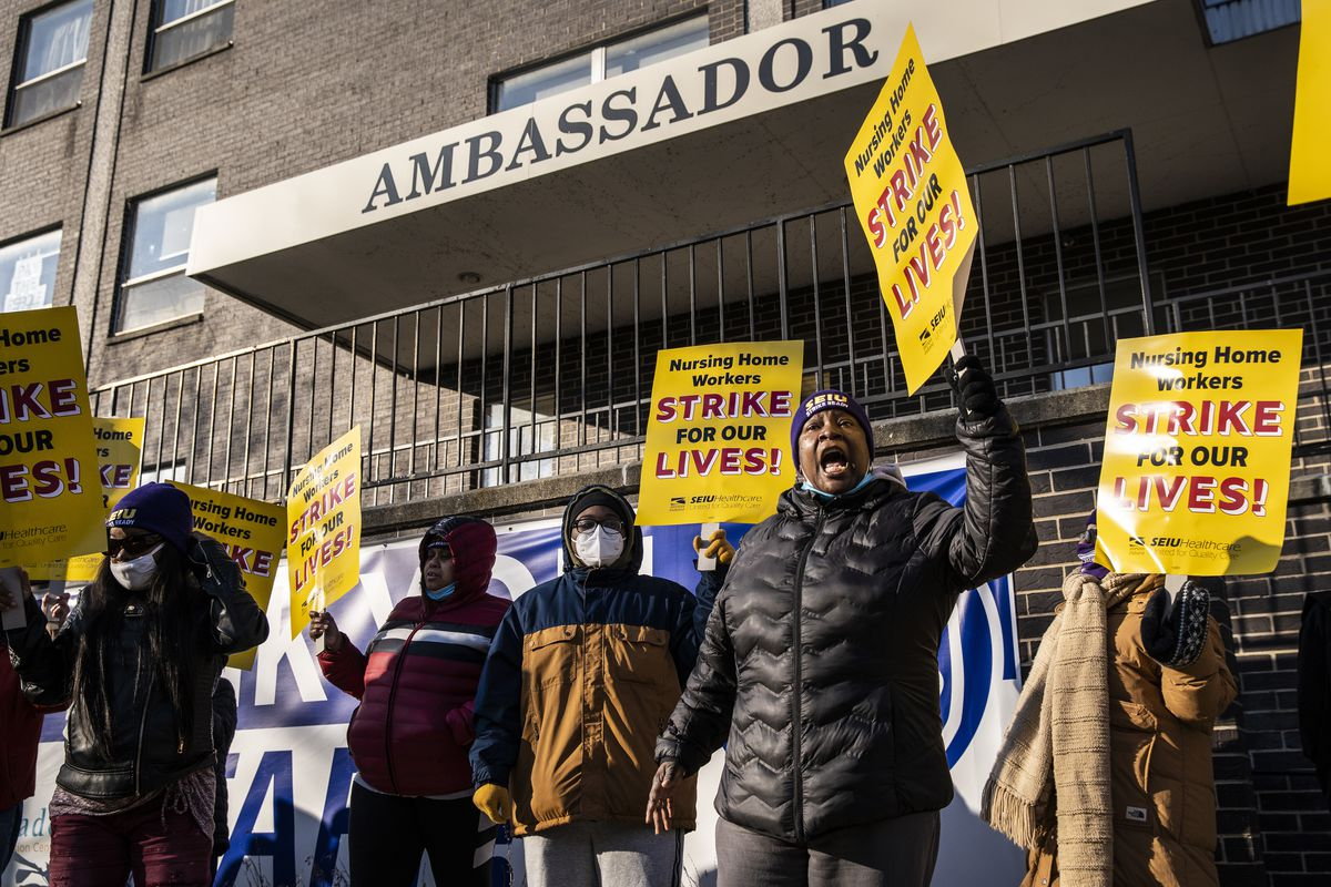 Annette Delaney, 54, a travel escort at Ambassador Nursing & Rehabilitation Center in Albany Park, leads a rally of striking Infinity Healthcare Management workers Monday morning outside the Northwest Side facility.