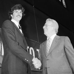 Danny Vranes of Utah, left, poses with National Basketball Association Commissioner Lawrence O'Brien after the NBA draft in New York, June 9, 1981. Vranes, who averaged 17.5 points per game for Utah last season, was selected by the Seattle Sonics.