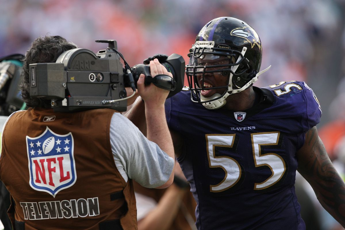 Terrell Suggs #55 of the Baltimore Ravens celebrates in front of a network television camera after recovering a fumble against the Miami Dolphins during the AFC Wild Card game at Dolphin Stadium on January 4, 2009 in Miami, Florida.