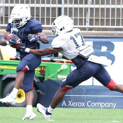 UConn's Aaron Turner #5 makes a catch in front of Stan Cross #17 during the Huskies open practice at Pratt & Whitney Stadium at Rentschler Field in East Hartford, CT on Saturday, August 14, 2021.