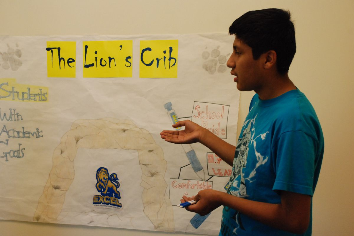 A student at STRIVE Excel rehearses a script for a student store run by the students in the school's new center.