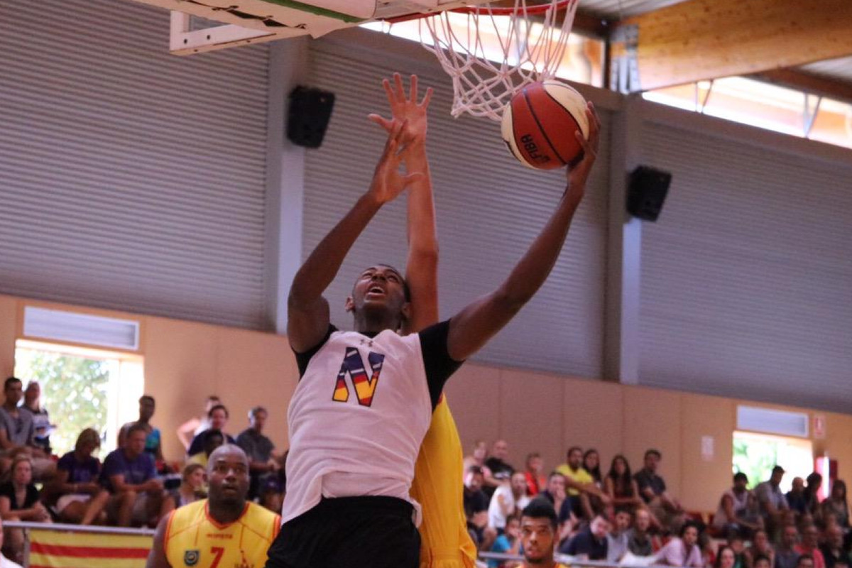 Dererk Pardon attempts a layup during NU's 70-44 win over USA Toulouges on Sunday.