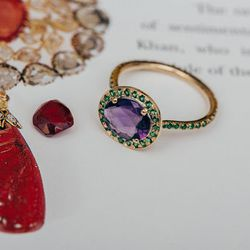 """<b>The Pick:</b> Amethyst and tsavorite garnet 'Delilah' ring, <a href=""""https://catbirdnyc.com/shop/product.php?productid=19643&cat=0&page=1"""">$1748</a>"""