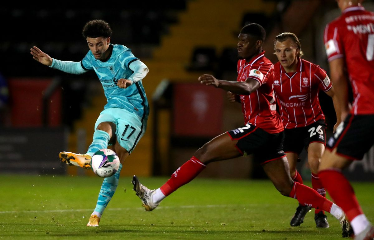 Lincoln City v Liverpool - Carabao Cup Third Round - Curtis Jones of Liverpool scores his teams third goal during the Caraboa Cup Third Round match between Lincoln City FC and Liverpool FC at LNER Stadium on September 24, 2020