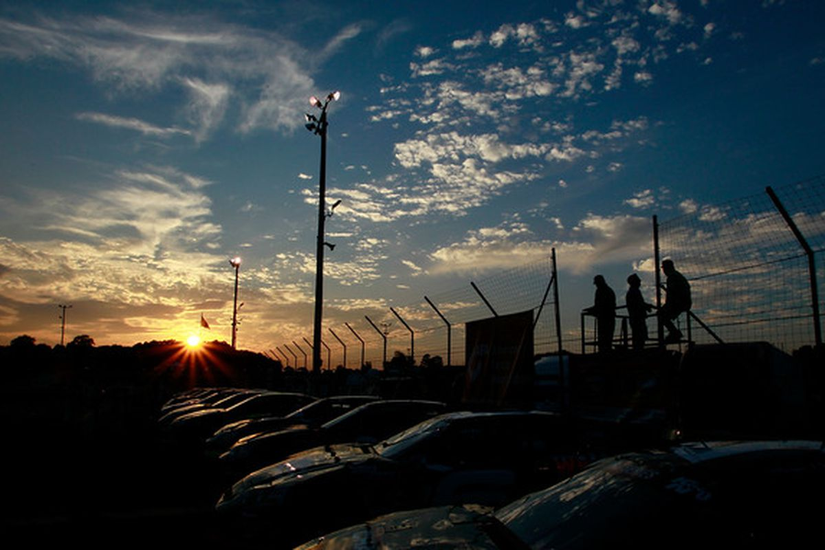 JEFFERSON GA - AUGUST 28:  The sun sets over the cars as they sit in the pits before the start of the NASCAR K&N Pro Series East at Gresham Motorsports Park on August 28 2010 in Jefferson Georgia.  (Photo by Kevin C. Cox/Getty Images for NASCAR)