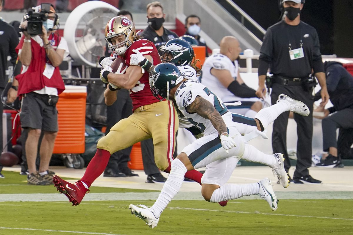 San Francisco 49ers tight end George Kittle (85) catches the football against Philadelphia Eagles cornerback Cre'von LeBlanc (34) and safety Marcus Epps (22) during the second quarter at Levi's Stadium