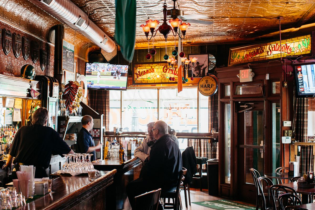 Owner Pat Osman looks out the window of Nemo's, a classic baseball bar in Corktown.