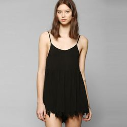 """UNIF frayed hem babydoll romper, $149 at <a href=""""http://www.urbanoutfitters.com/urban/catalog/productdetail.jsp?id=30765184&parentid=SEARCH+RESULTS"""">Urban Outfitters</a>"""