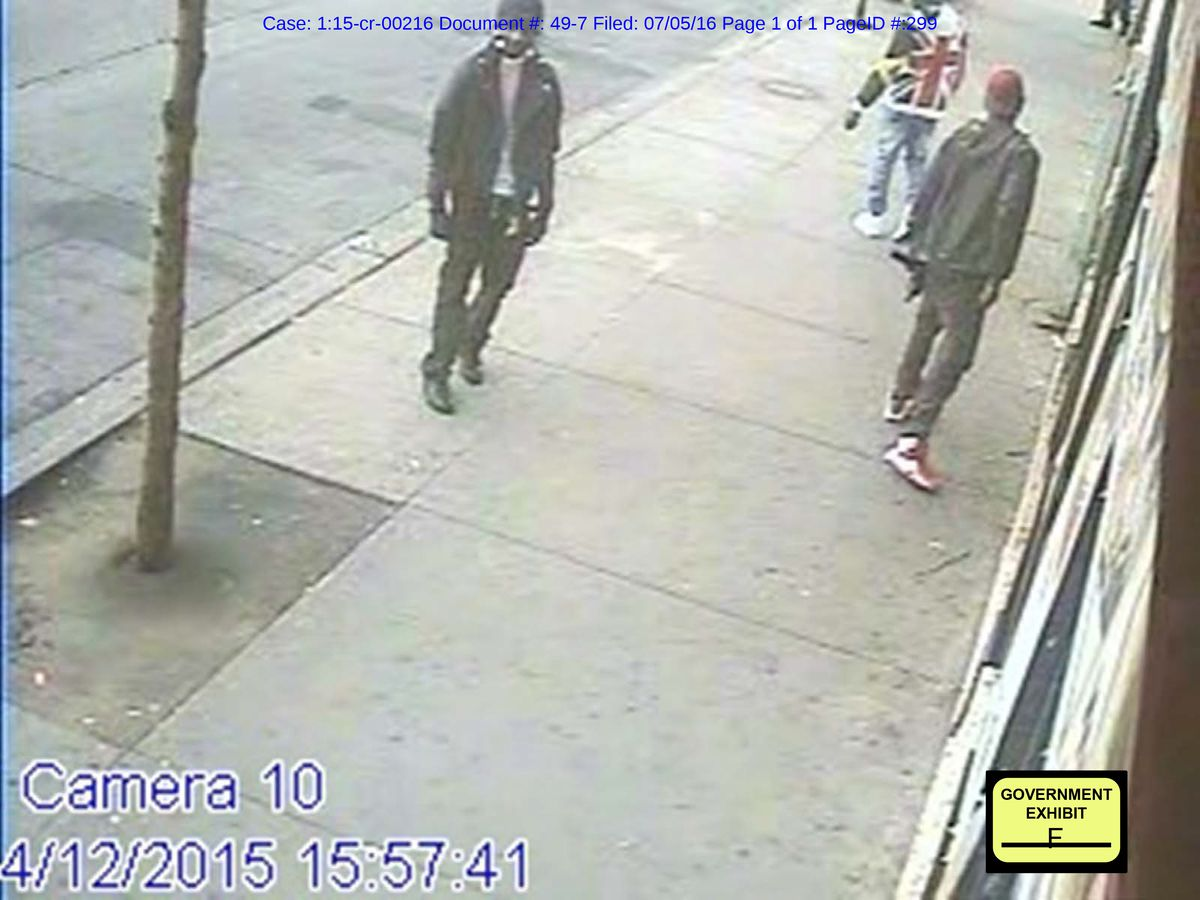 Tyrell Thomas (in the red cap), a West Side gang member who switched allegiance to Thaddeus Jimenez's Simon City Royals, carrying a Master Piece Arms .45-caliber submachine-gun before a robbery on April 12, 2015.