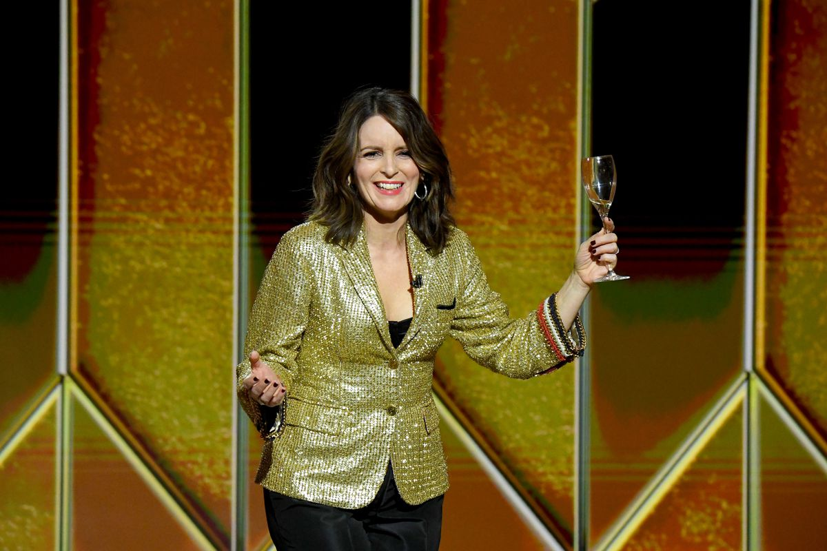 Tina Fey holds up a wineglass while hosting the 2021 Golden Globe Awards