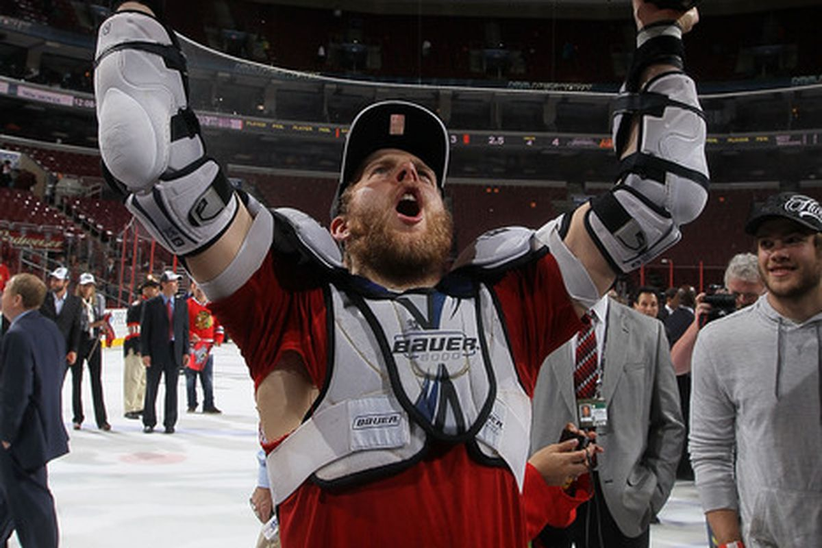 Kris Versteeg lifts the Stanley Cup - for the first time.  (Photo by Jim McIsaac/Getty Images)