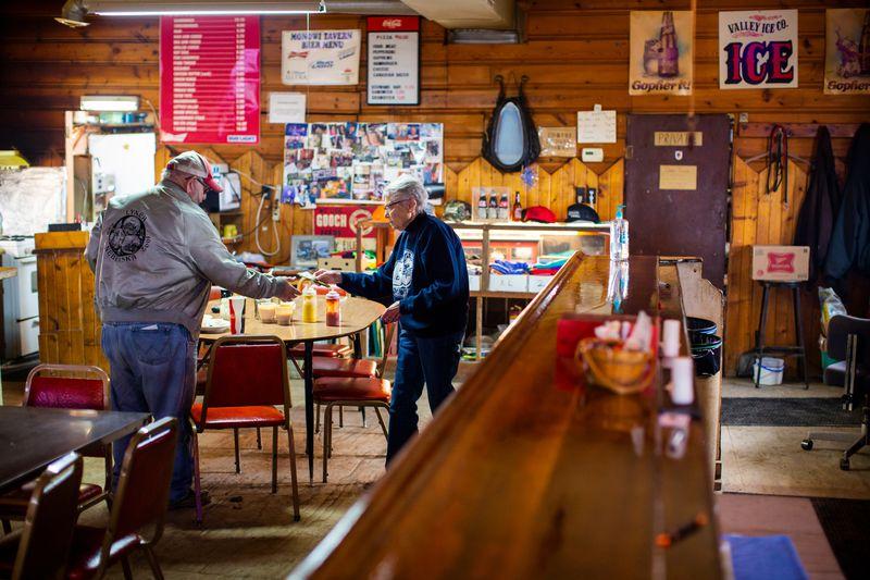 Elsie waits on a customer in the tavern.