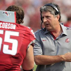 Washington State coach Mike Leach, right, talks to offensive lineman Wade Jacobson (55) during the first half of an NCAA college football game against Colorado, Saturday, Sept. 22, 2012, at Martin Stadium in Pullman, Wash.