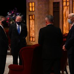 Elder David A. Bednar, left, Elder Neil L. Andersen, Elder Ulisses Soares and Elder Dale G. Renlund of the Quorum of the Twelve Apostles converse before the Sunday afternoon session of the 190th Semiannual General Conference of The Church of Jesus Christ of Latter-day Saints on Oct. 4, 2020.