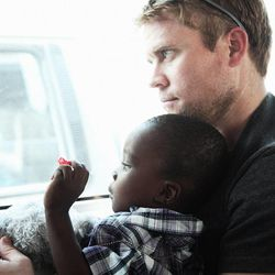 O.U.R. founder Tim Ballard holds one of the 200 children rescued during 2014.