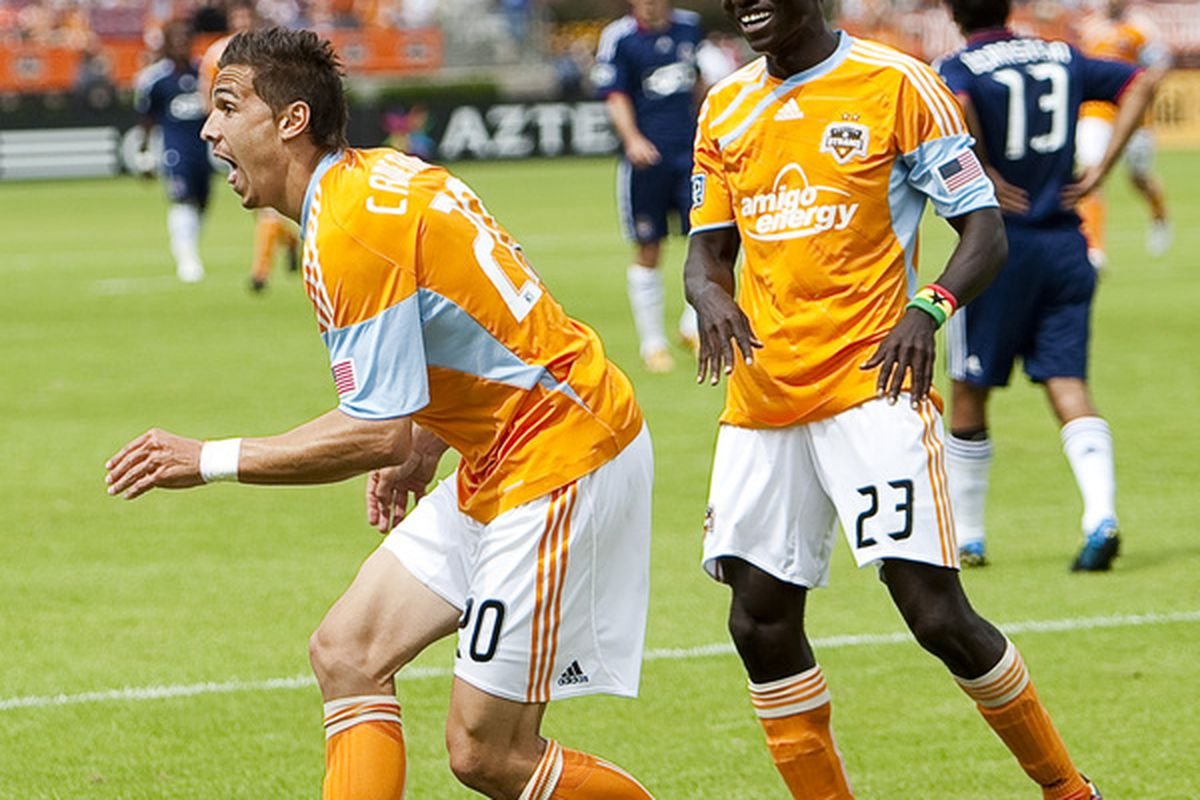 HOUSTON - APRIL 17:  Geoff Cameron #20 of the Houston Dynamo celebrates with Dominic Oduro #23 after scoring in the first half against Chivas USA at Robertson Stadium on April 17, 2010 in Houston, Texas.  (Photo by Bob Levey/Getty Images)