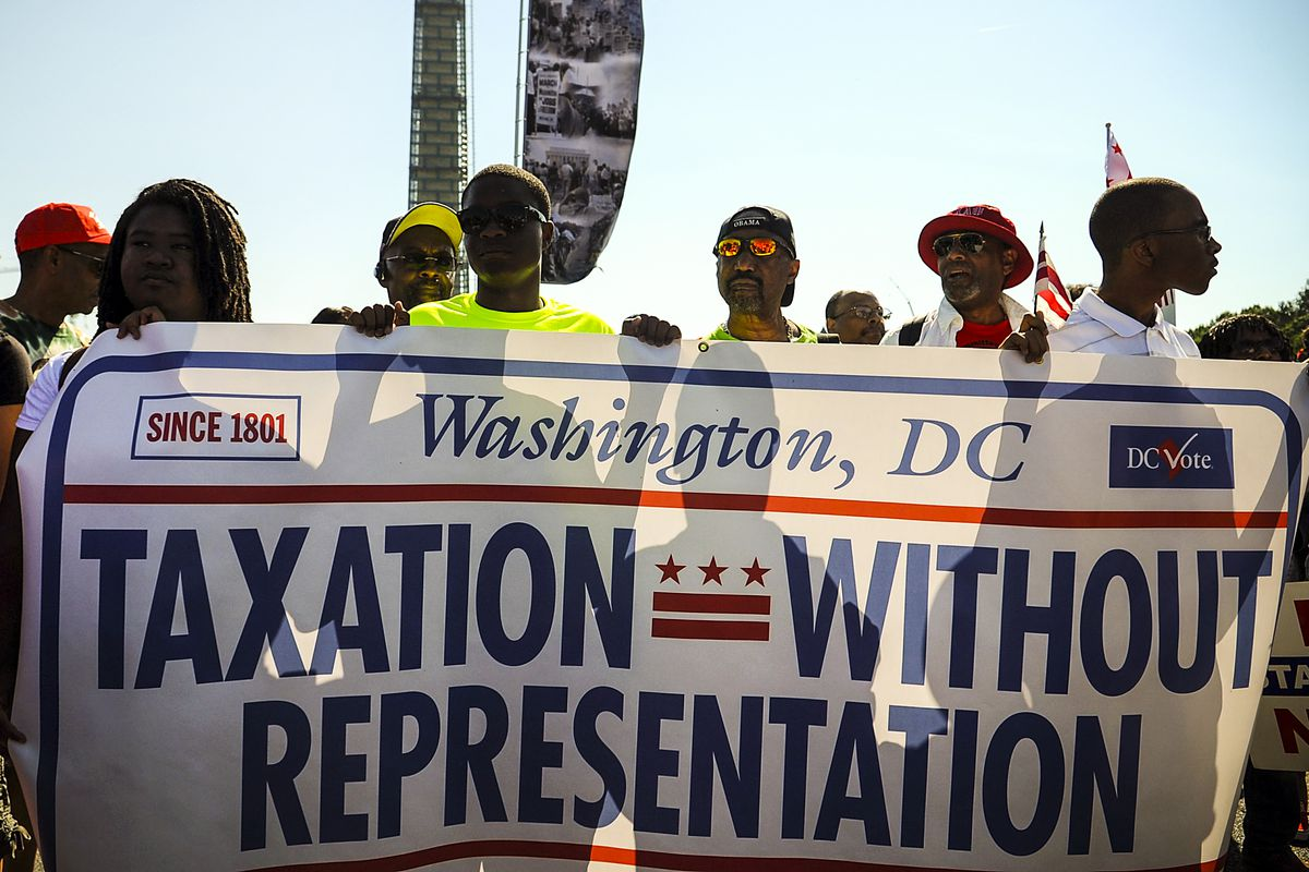 D.C. residents gather for a D.C. Statehood rally and march before joining a larger rally commemorating the 50th anniversary of the March on Washington, on August 24, 2013.