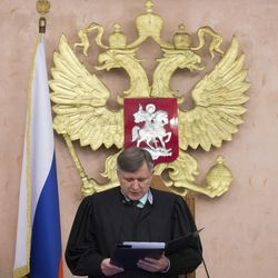 Russia's Supreme Court judge Yuri Ivanenko reads the decision in a court room in Moscow, Russia, on Thursday, April 20, 2017, to ban Jehovah's Witnesses. A bipartisan religious freedom commission on Wednesday slammed Russia for ongoing and egregious religious intolerance.