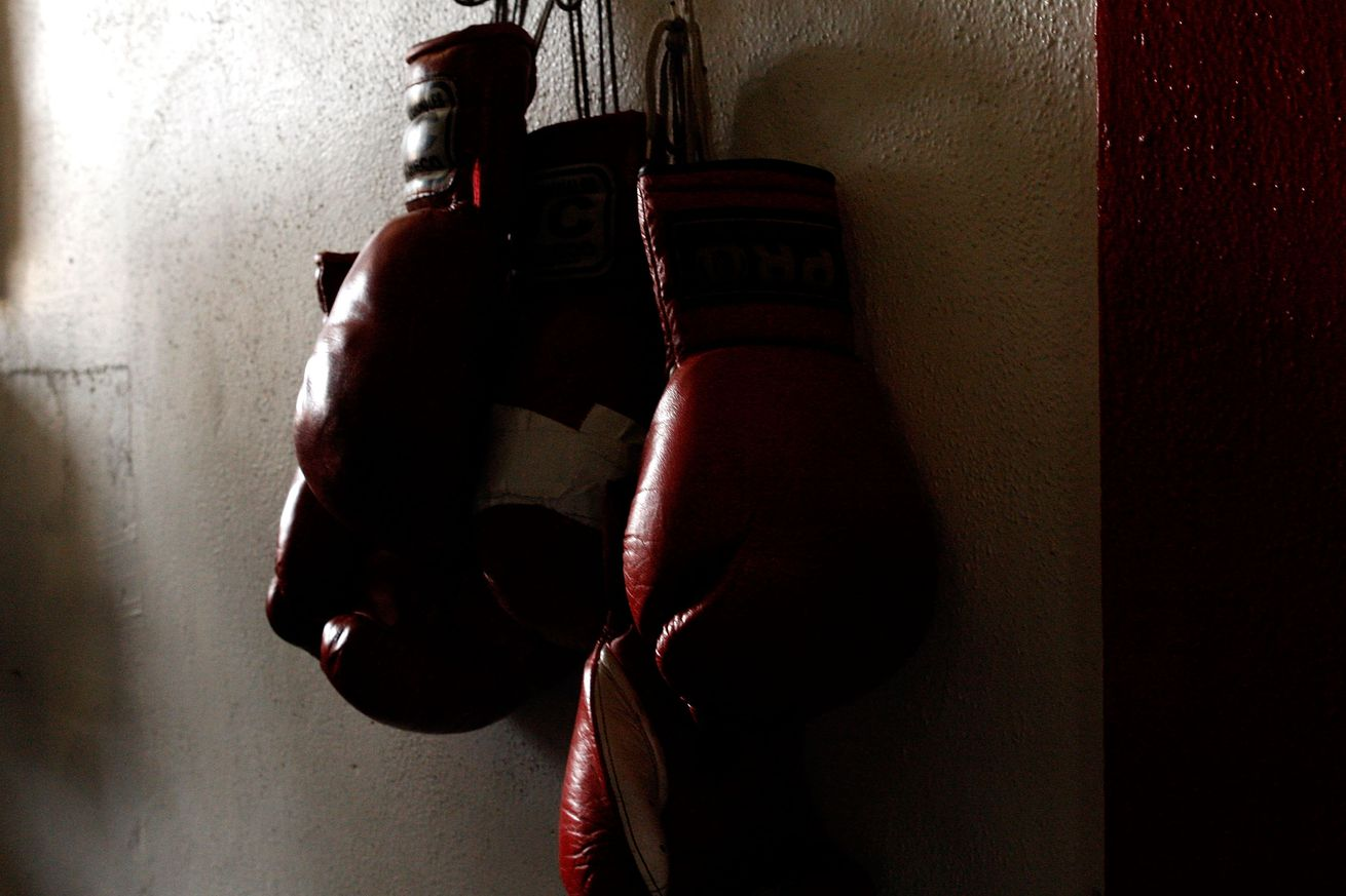 FILE PHOTO - September 29th, 2009, boxing gloves hang on the wall of Urbina Westside Boxing Gym in Los Angeles, California.