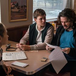 """Director Edgar Wright with Lily James and Ansel Elgort, center, on the set of """"Baby Driver."""""""