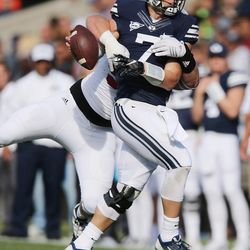 Brigham Young Cougars quarterback Taysom Hill (7) has the ball stripped by Southern Utah Thunderbirds defensive lineman Robert Torgerson (97)  in Provo on Saturday, Nov. 12, 2016.