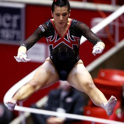 Utah's Alexia Burch performs on the bars as Utah and Washington compete in an NCAA gymnastics meet at the Huntsman Center in Salt Lake City on Saturday, Jan. 30, 2021. No. 4 Utah won 197.475 to 193.300.