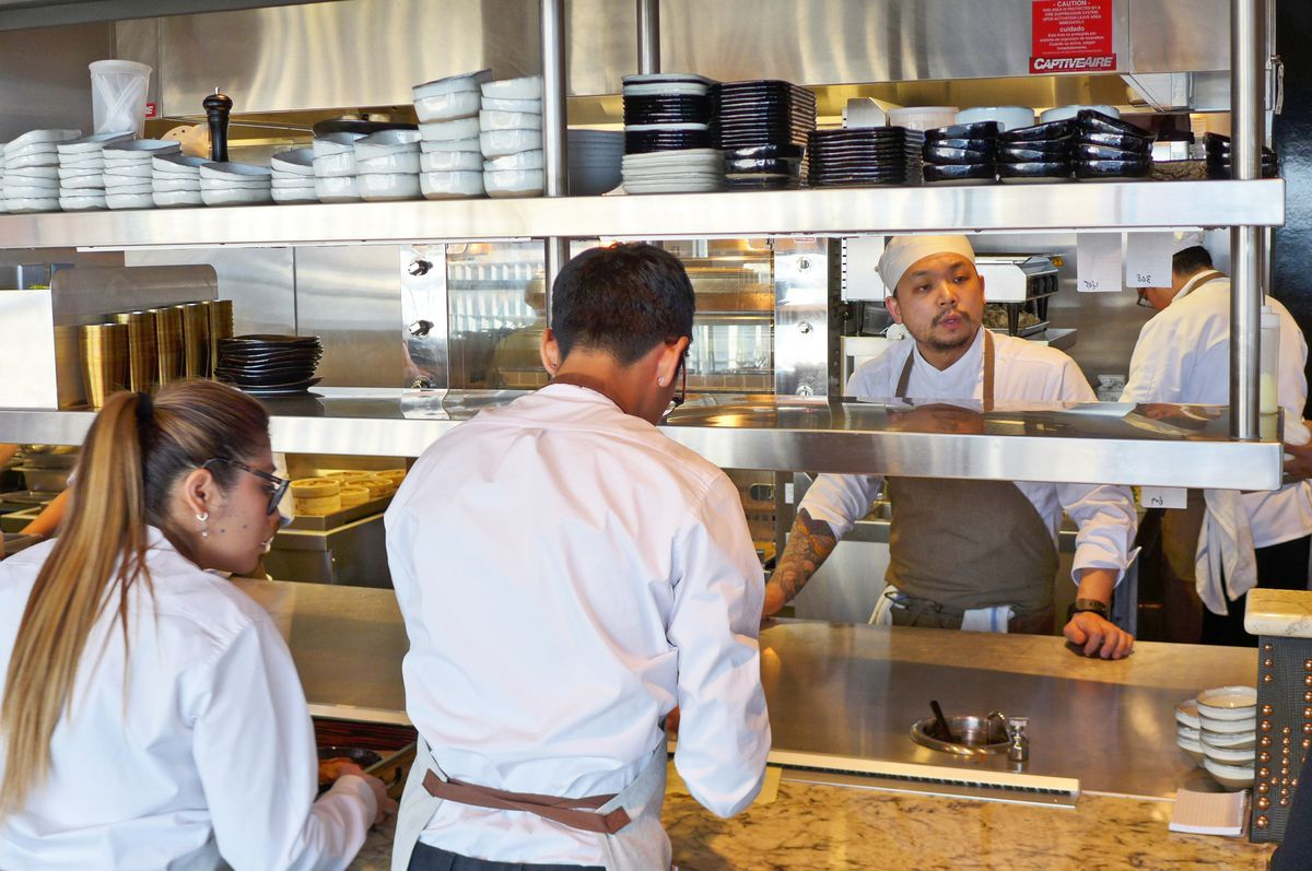 At the pass, chef Peter Jin