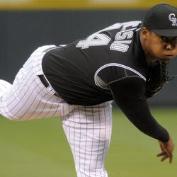 Colorado Rockies starting pitcher Juan Nicasio throws to the plate against the Arizona Diamondbacks during the first inning of a baseball game on Friday, April 13, 2012, in Denver.