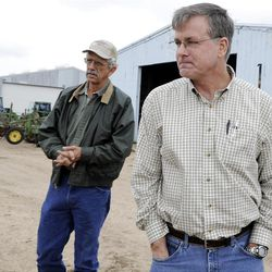 Billy Hefner, left, and Ron Gertson talk about the rice farming industry at Gertson's farm in Lissie, Texas, in February. The latest agricultural census figures show the fastest growing group of farmers and ranchers are those over age 65.