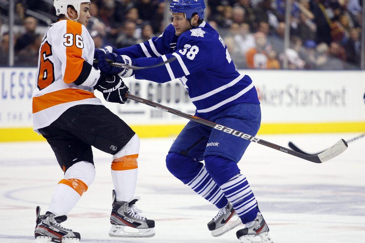 March 29, 2012; Toronto, ON, CANADA; Toronto Maple Leafs left wing Jay Rosehill (38) shoves Philadelphia Flyers forward Zac Rinaldo (36) at the Air Canada Centre. Philadelphia defeated Toronto 7-1. Mandatory Credit: John E. Sokolowski-US PRESSWIRE