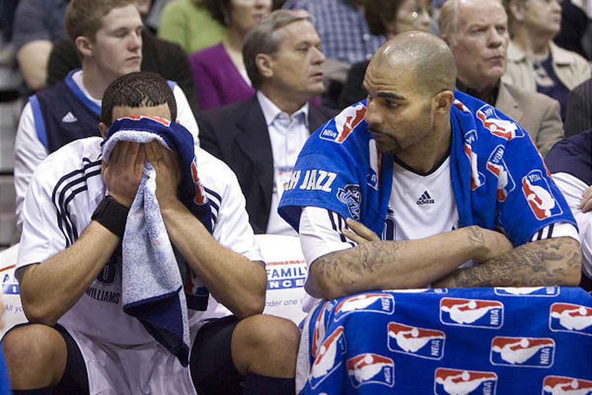 Deron Williams and Carlos Boozer spend the final 2 minutes of the game from the bench during the game with the Los Angeles Lakers at the Energy Solutions Arena in Salt Lake City on Feb., 10, 2010.