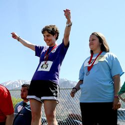 Kira Uchida, of the Weber State Wildcats, second from left, celebrates her first-place win in the 50-meter race at the Special Olympics Utah's 48th annual Summer Games at Provo High School on Friday, June 2, 2017. Nearly 1,300 athletes will compete during the two-day event with support from nearly 500 coaches and hundreds of volunteers.