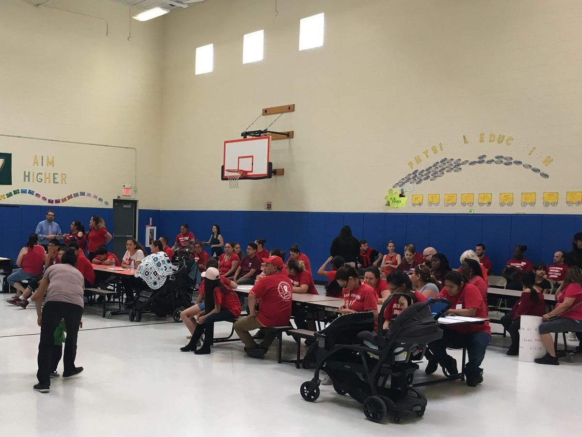 Parents filled the gym at Southwest Detroit Community School last month to protest administrator turnover and demand a new contract for teachers.