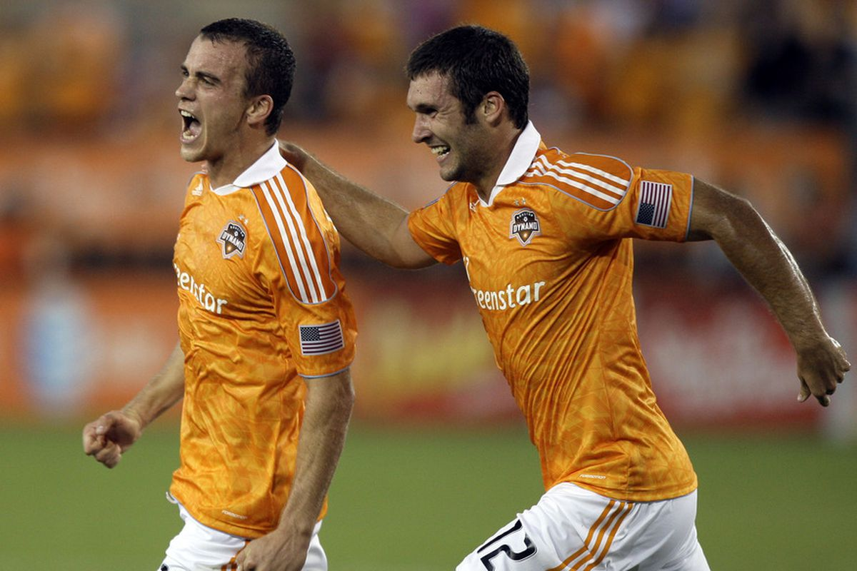 HOUSTON - MAY 28: Cam Weaver #15 of the Houston Dynamo celebrates with Will Bruin #12 after scoring in the first half against FC Dallas at Robertson Stadium on May 28, 2011 in Houston, Texas. (Photo by Bob Levey/Getty Images)
