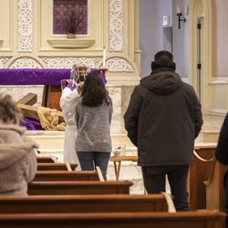 Congregants lines up to receive the imposition of ashes from Father Tom Hurley at Old St. Patrick's Catholic Church on the Near West Side on Ash Wednesday, Feb. 17, 2021.