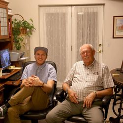 Boman Farrer and his grandfather, Calvin, sit together in Calvin's home.