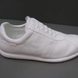 One of the resin replicas of Camper's popular Pelotas style sneaker.