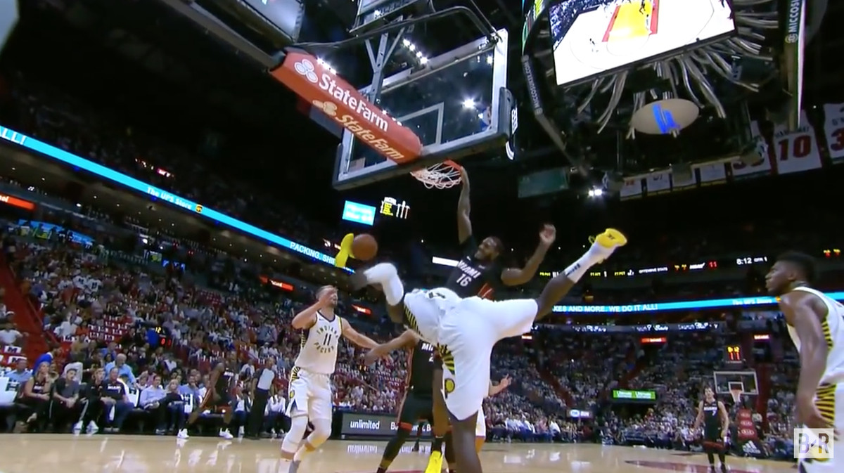 Victor Oladipo's right leg flails in the air after James Johnson dunks on him