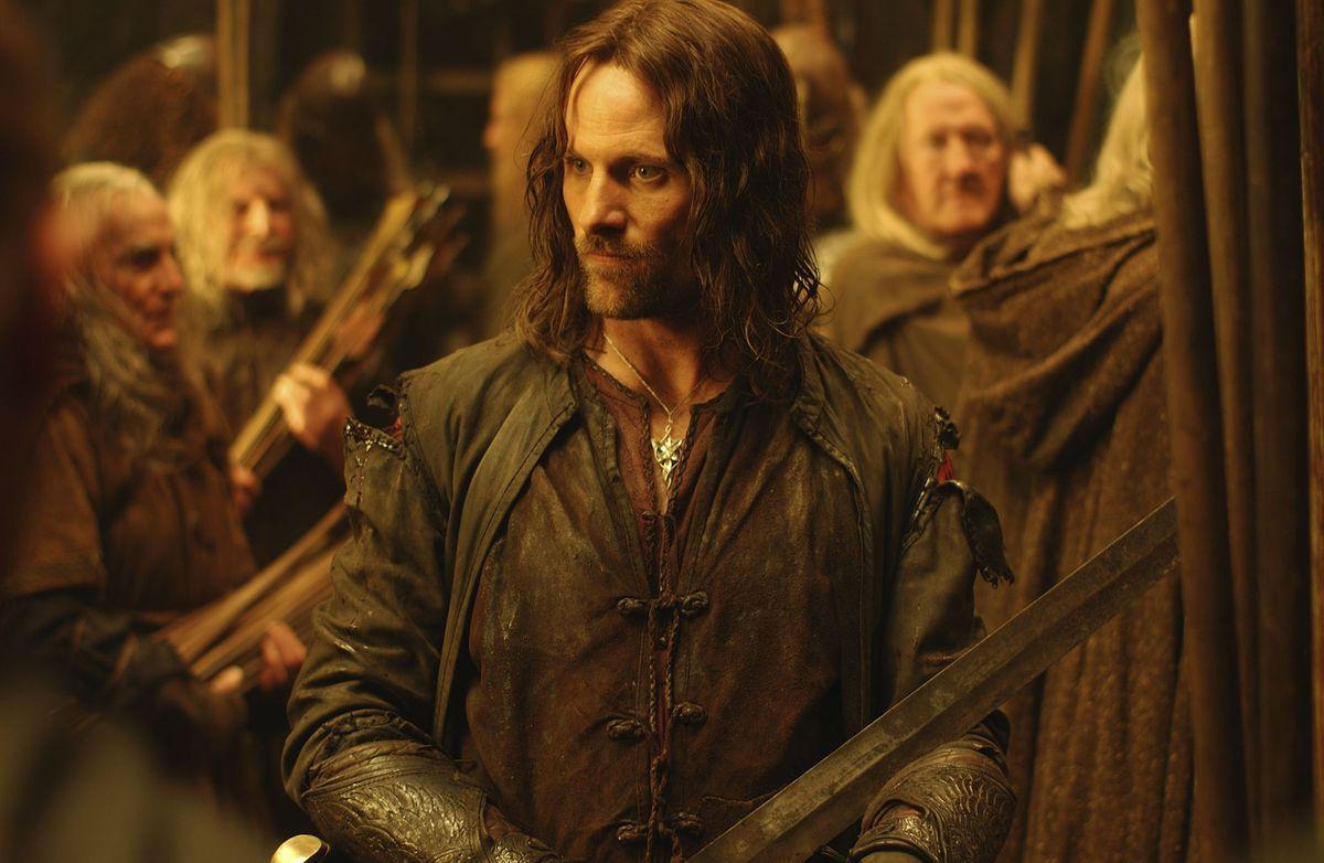 Aragorn (Mortensen) surrounded by men of Rohan.