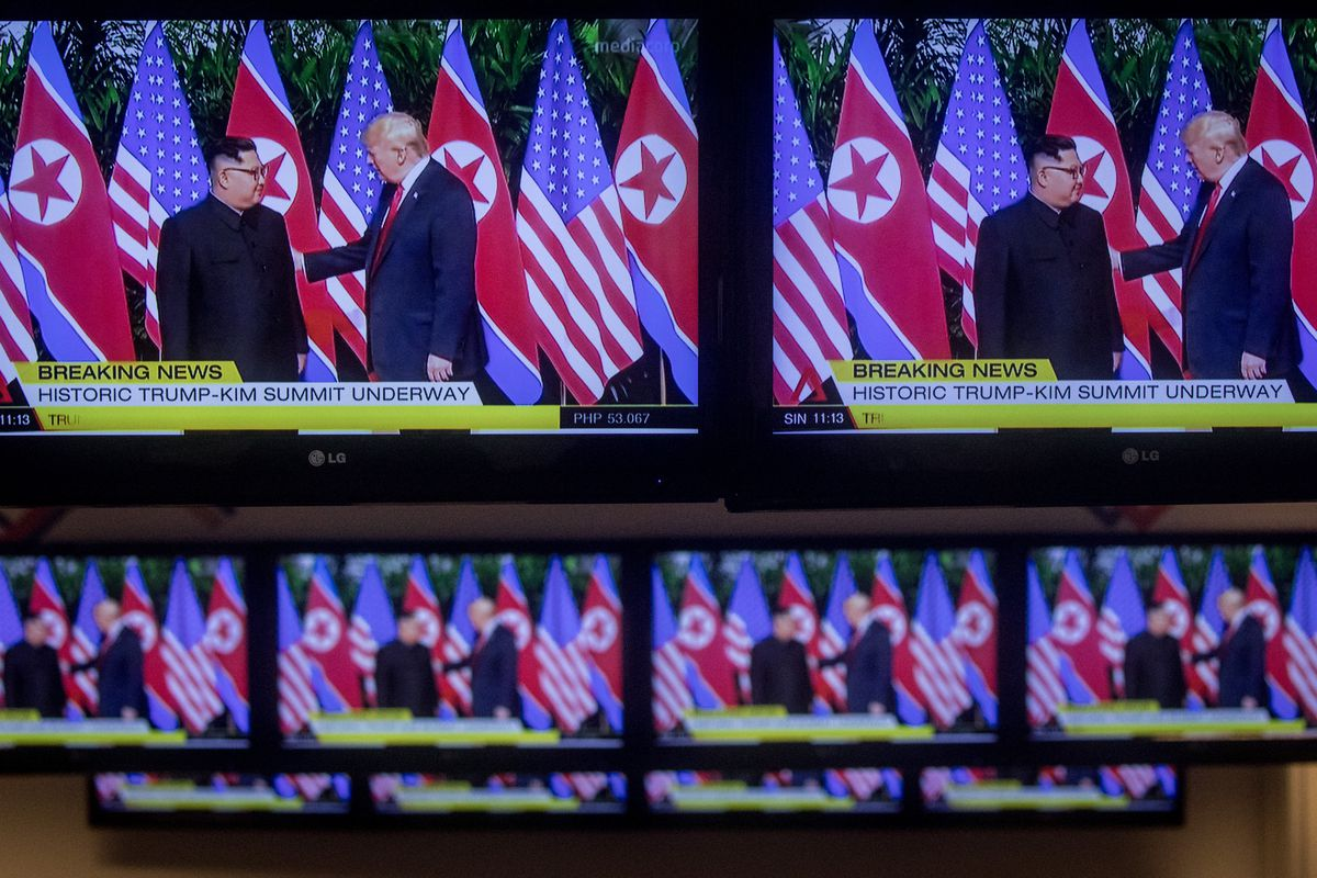 Rows of TV screens show footage of the meeting between US President Donald Trump and North Korean leader Kim Jong Un on June 12, 2018 in Singapore.