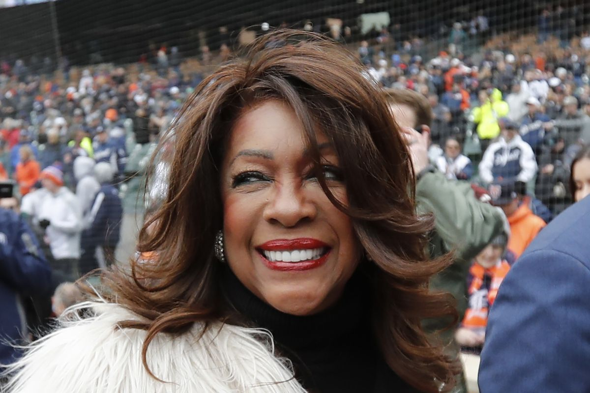 Mary Wilson is escorted after singing the national anthem before a baseball game in 2019 between the Detroit Tigers and the Kansas City Royals in Detroit.