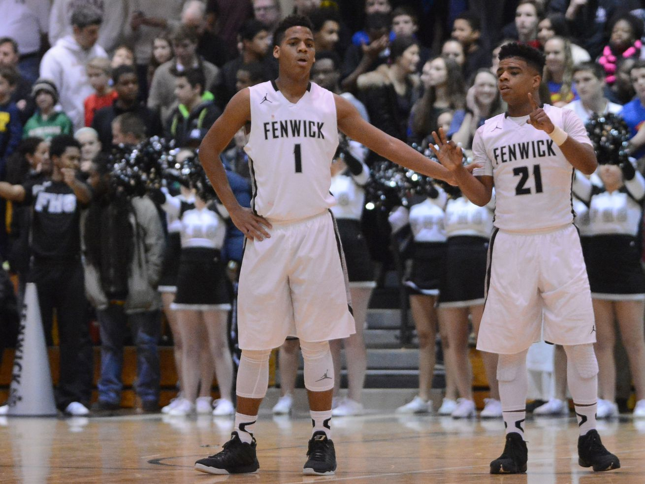 Fenwick's Jacob Keller (1) and Mike Smith (21) talk during a free throw.