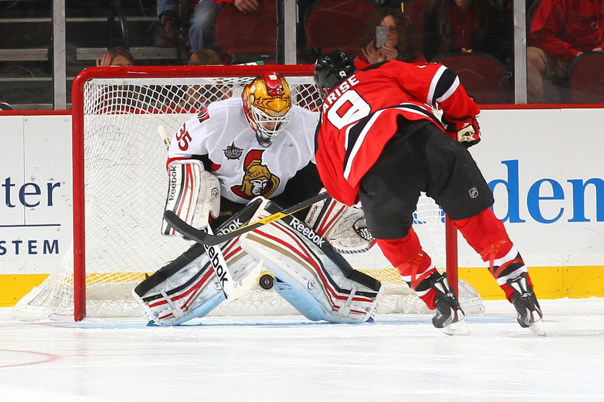 Alex Auld's poor effort on this Zach Parise shootout goal wasn't the only reason the Senators collapsed. (Photo by Al Bello/Getty Images)