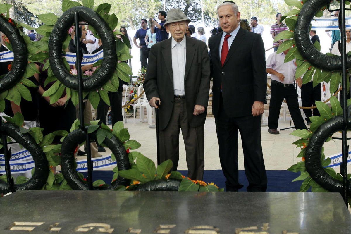 FILE - In this July 11, 2010 file photo  Israeli Prime Minister Benjamin Netanyahu, right, and his father Benzion attend the official memorial service for the late Zionist leader Ze'ev Jabotinsky at the Mt. Herzl cemetery in Jerusalem. Benzion Netanyahu,